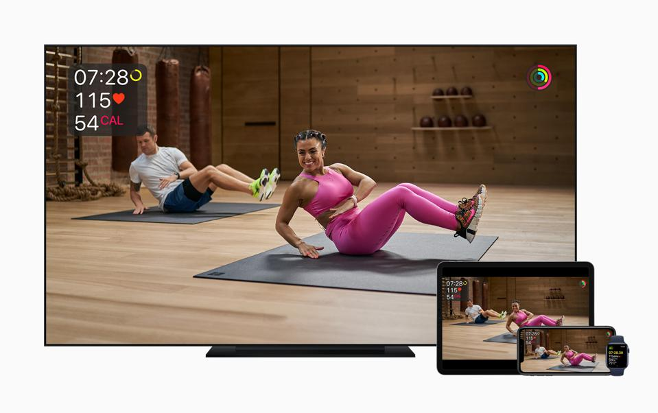 Apple Fitness+ on four different screens.