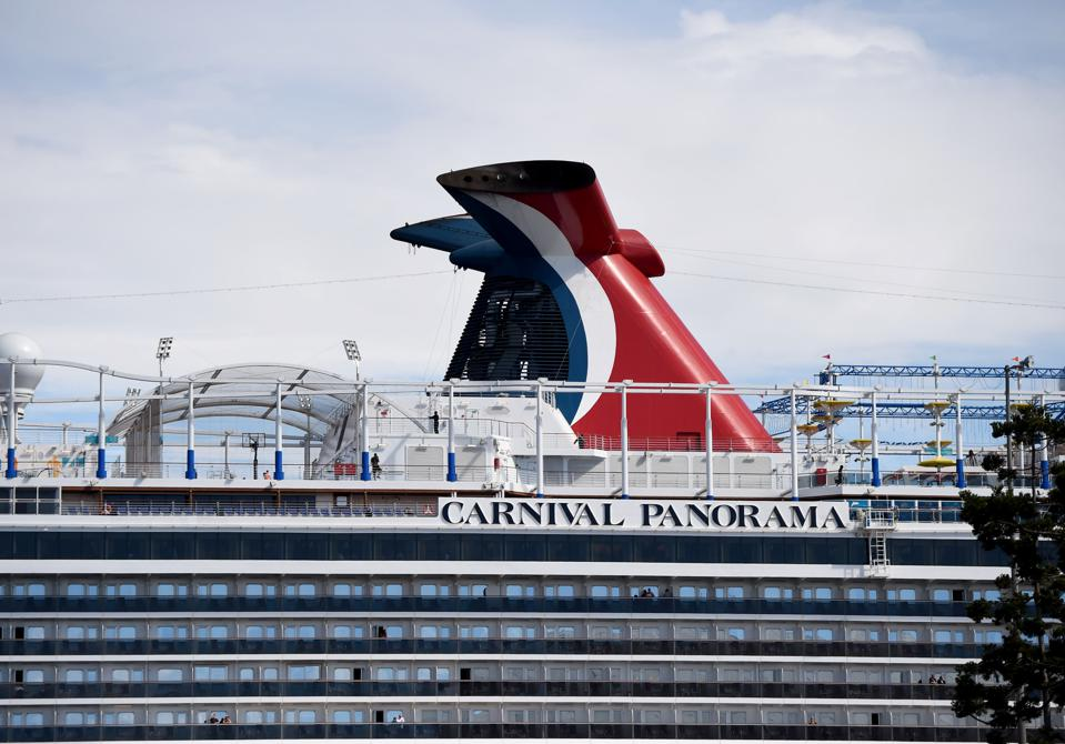 Carnival Panorama cruise ship delays disembarking as a passenger is tested for medical concerns.