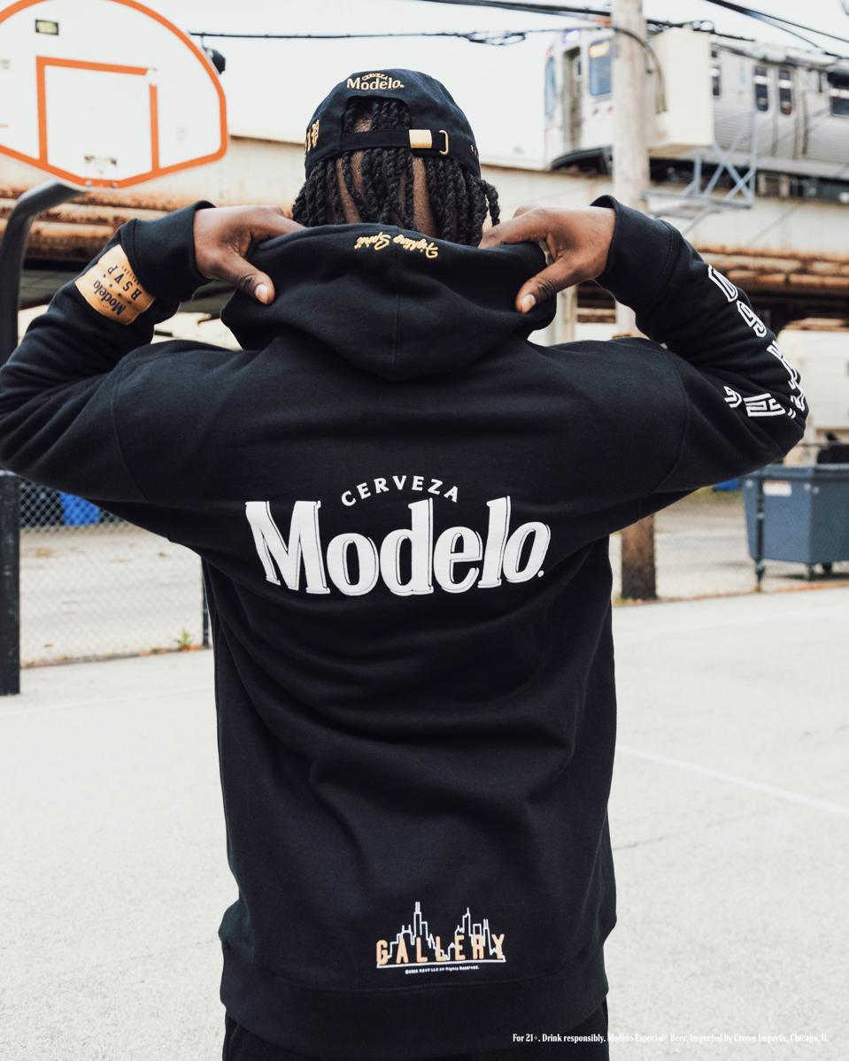 A model wears a sweatshirt for the Modelo beer and Chicago based RSVP Gallery