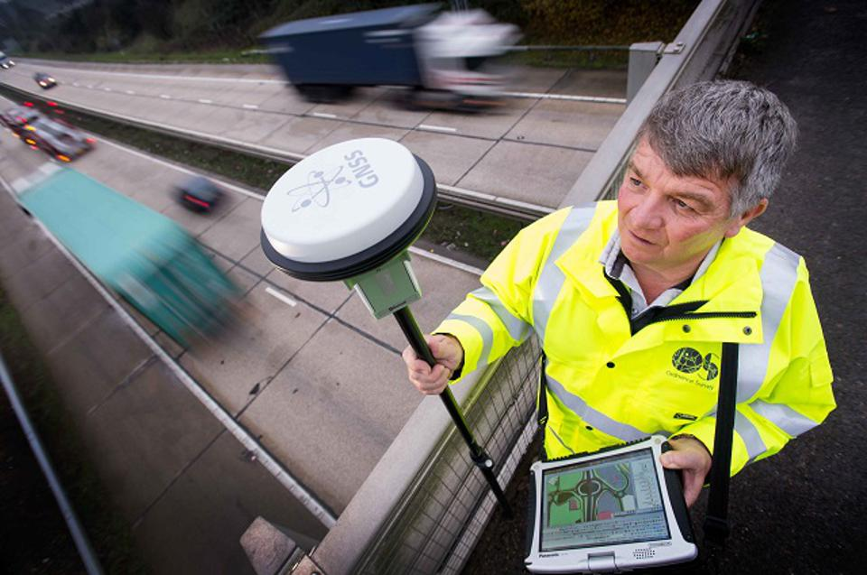 A surveyor with a Global Navigation Satellite System (GNSS) and toughbook kit.