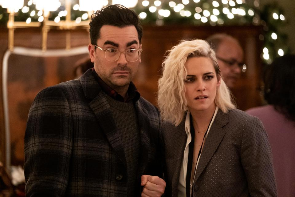 Dan Levy and Kristen Stewart during a scene in the film Happiest Season.