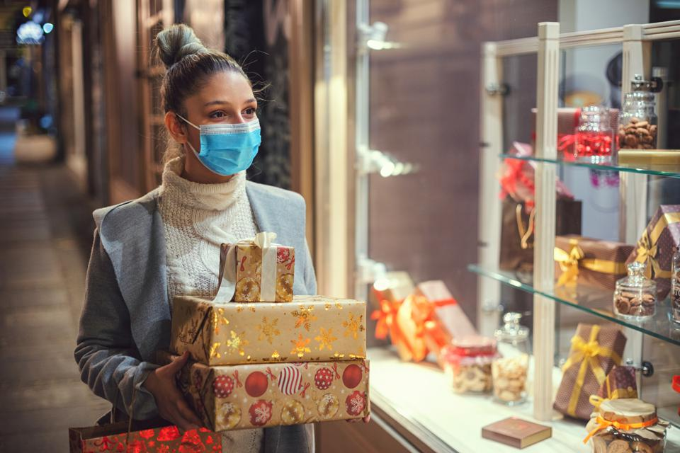 Female shopping Christmas gifts during COVID-19 pandemic