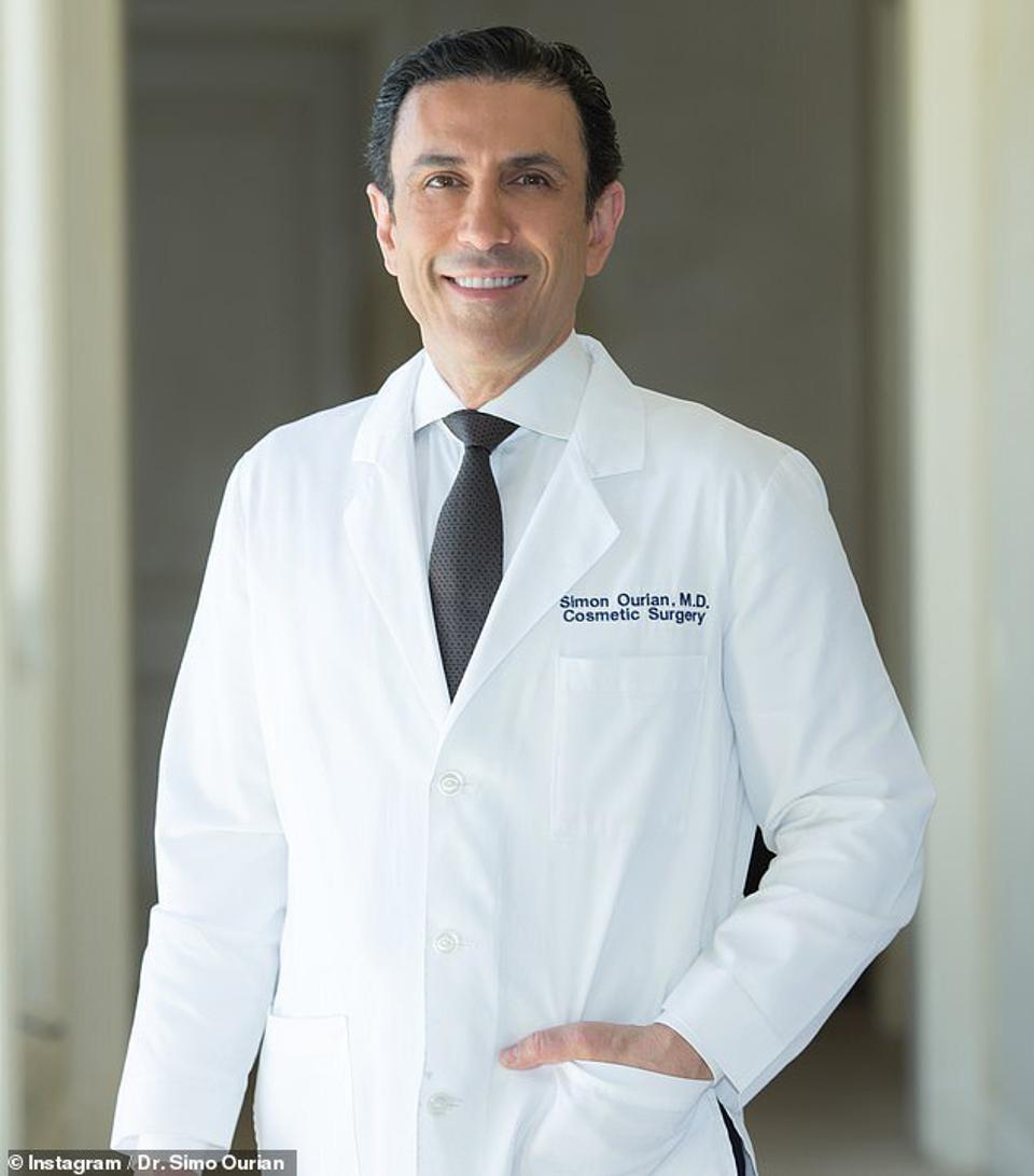 Portrait of Dr. Simon Ourion, cosmetic surgeon, in a lab coat