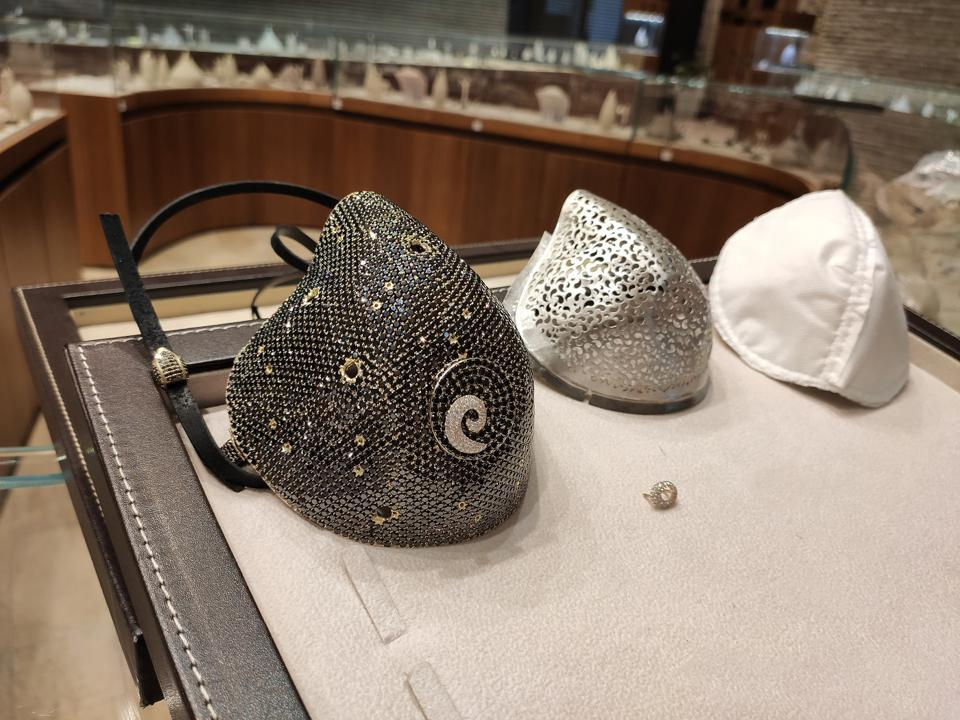 The separate parts of the bejeweled mask