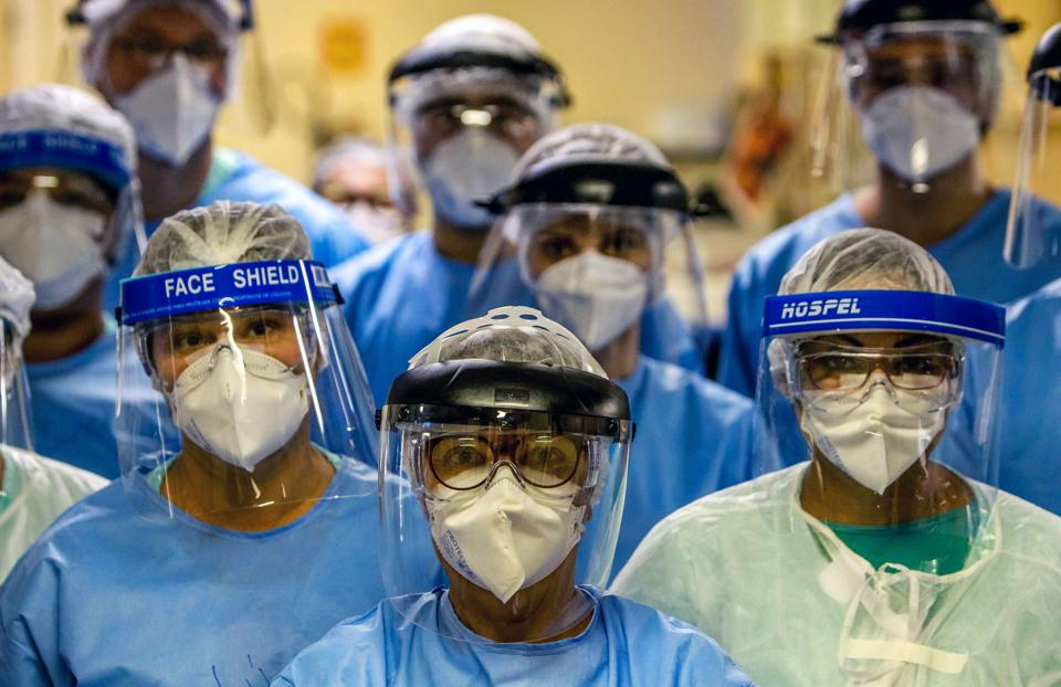 Doctors in masks and Covid shields
