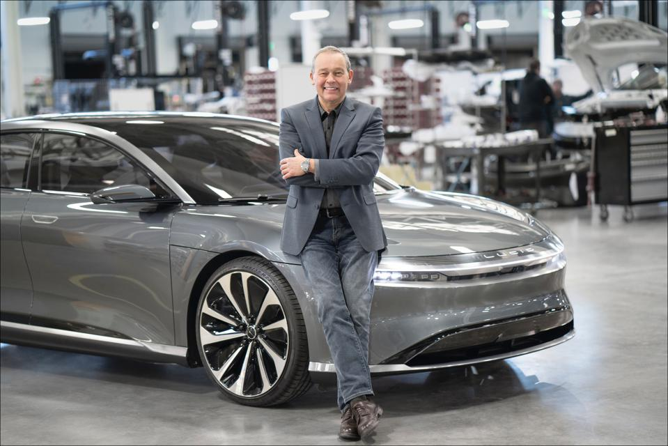 Lucid Motors CEO Peter Rawlinson with a pre-production Lucid Air.
