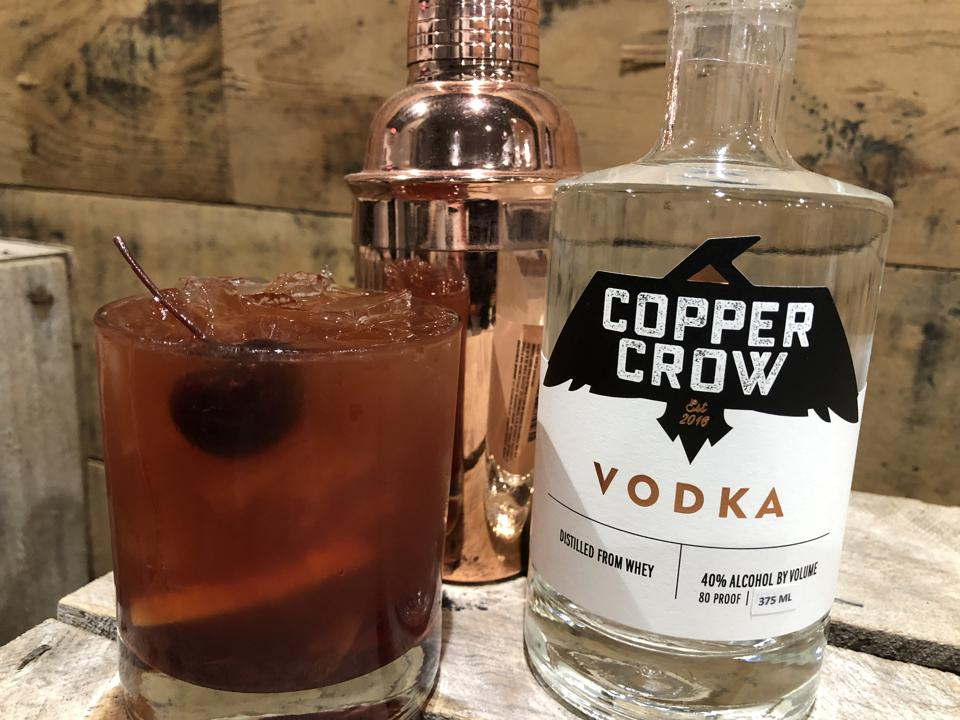 Old Fashioned cocktail and a bottle of Copper Crow vodka.