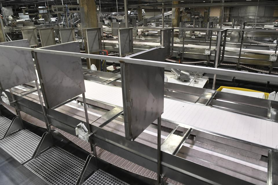 The reopening of the Greeley beef plant on April 23, 2020 included new sheet-metal partitions at each meat processing station.