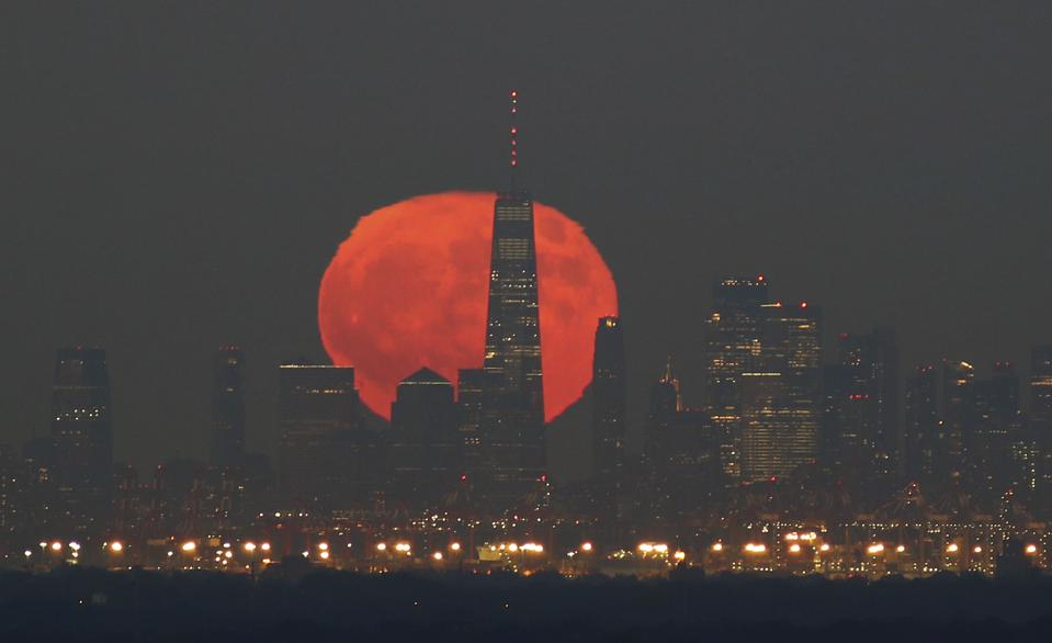 The moon appears red when its close to the horizon, due to Earth's atmospheric effects.