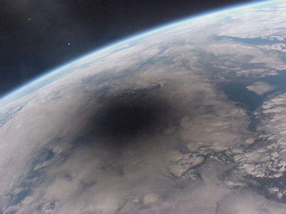 Moon's shadow on Earth as seen from space during a total eclipse.