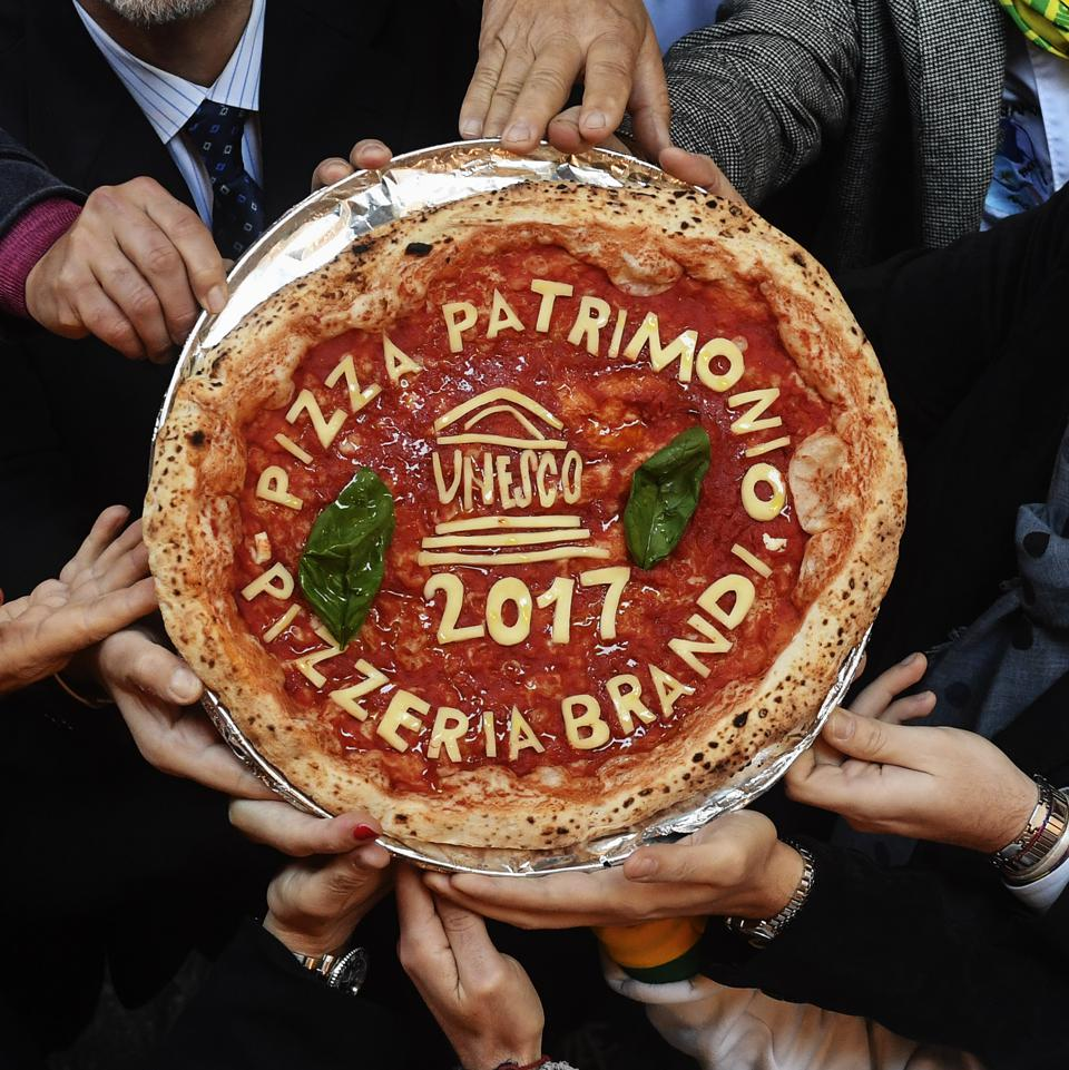The Neapolitan pizza with the words ″Unesco″. The art of the...