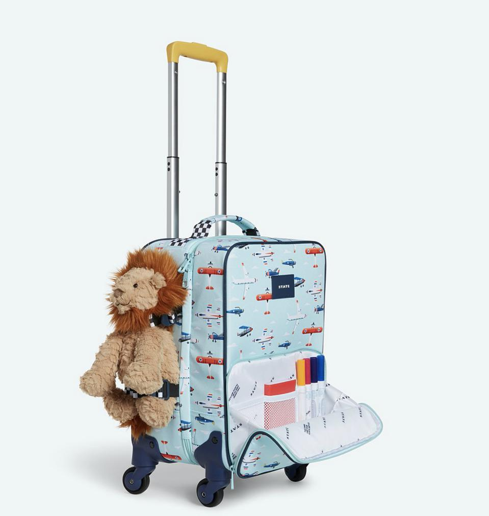 blue suitcase with stuffed animal