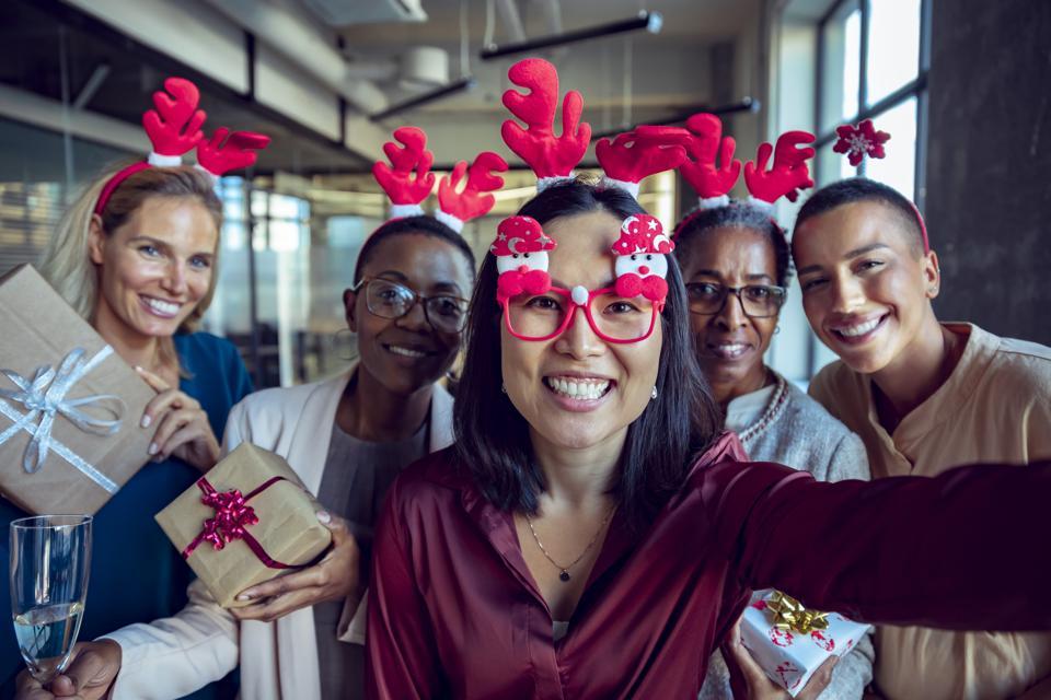 Female coworkers taking a Christmas Selfie