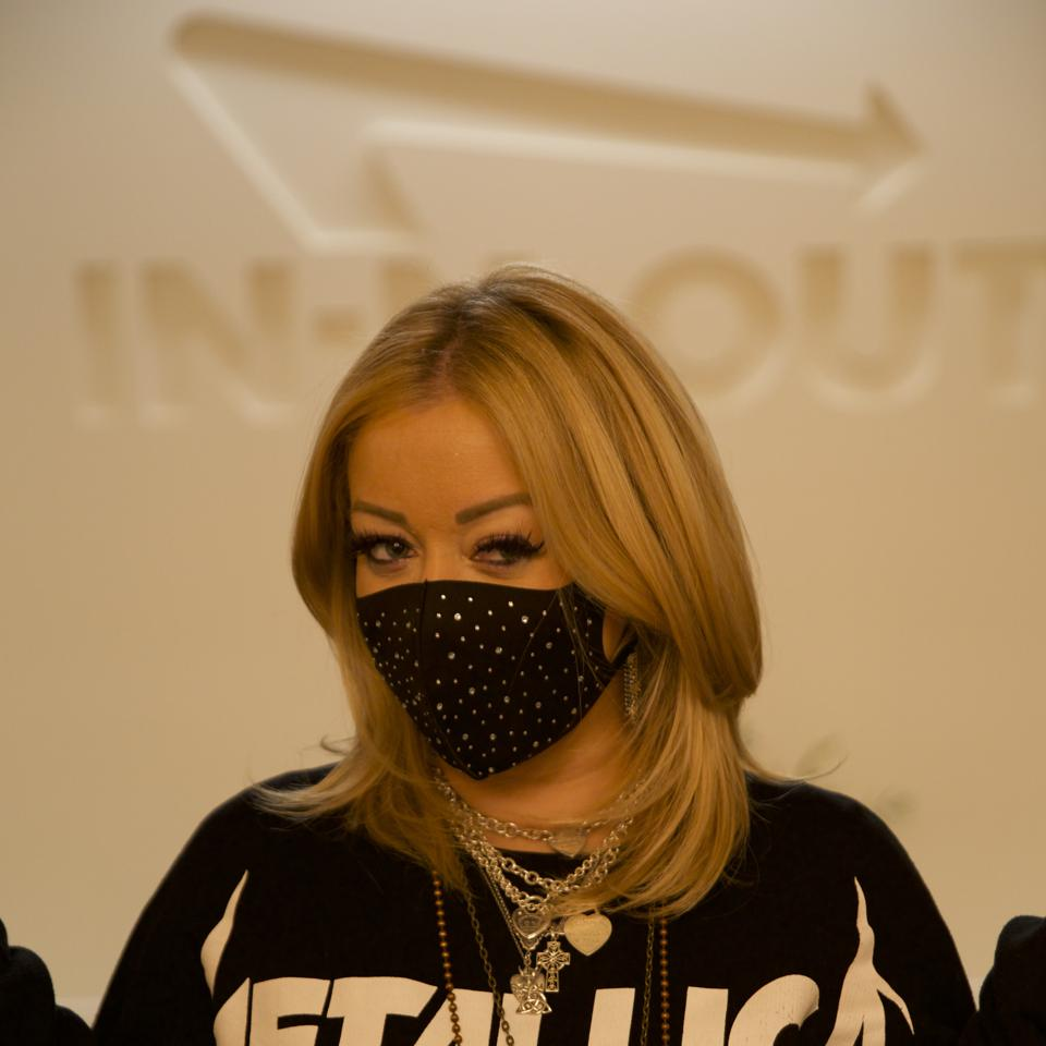 In-N-Out Burger President Lynsi Snyder, masked at a new location opening.