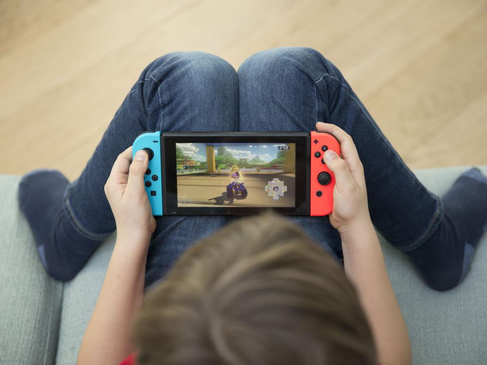 CHILD PLAYING VIDEO GAME