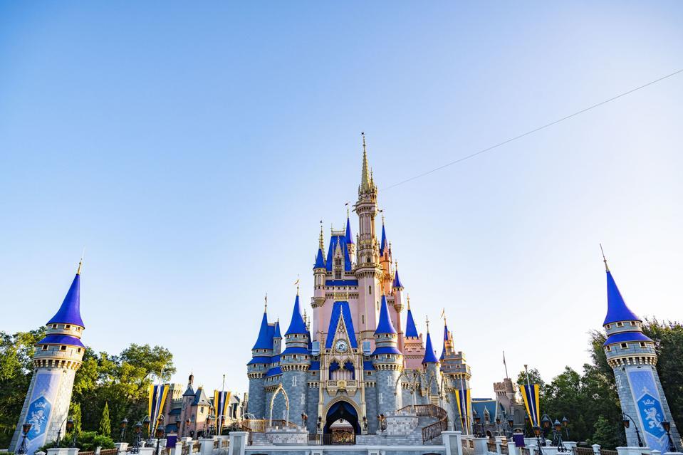 Cinderella Castle at Magic Kingdom painted blush pink and royal blue.