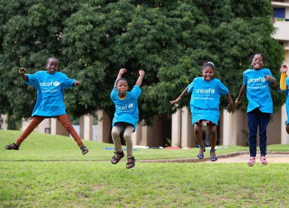From left: Koumba, Jean Uriel, Mariam and Yasmine jump for joy before World Children's Day 2020 in Abidjan, Côte d'Ivoire.