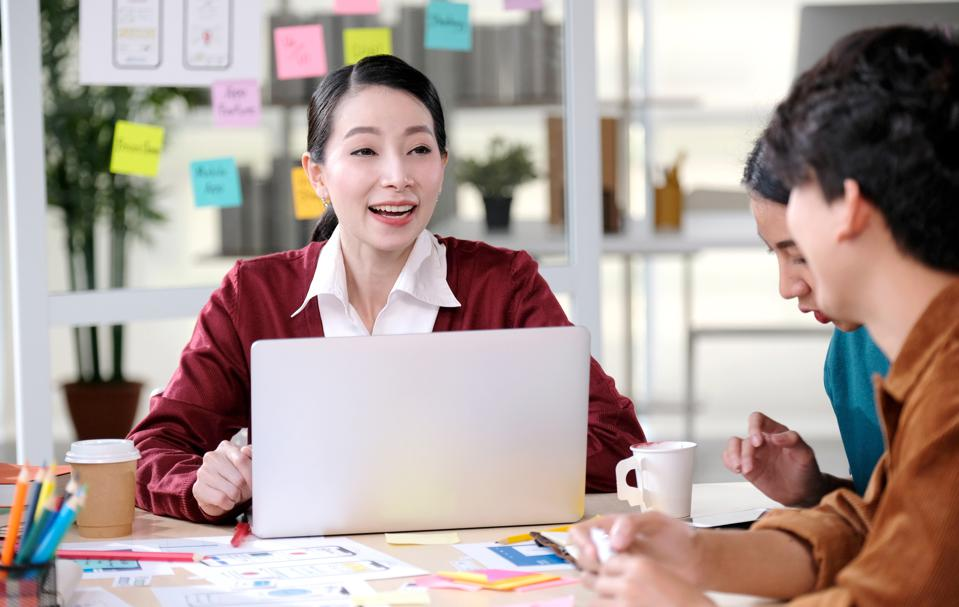 Asian office, Asia business people meeting team brainstorming strategy plan for small business startup, Woman professional leader discuss with coworker for decision at modern coworking space, business partner corporate company