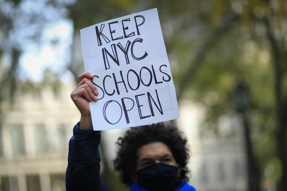 Parents protest demanding that public schools remain open, outside New York's City Hall on November 19, 2020. (Photo by Kena Betancur / AFP) (Photo by KENA BETANCUR/AFP via Getty Images)