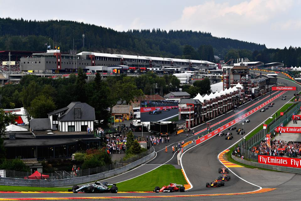 F1 drivers navigate the challenging Eau Rouge turn in the Grand Prix of Belgium