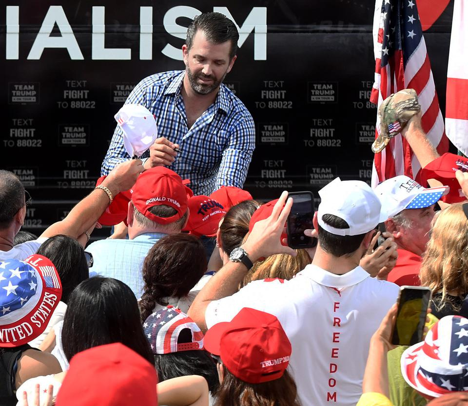 Donald Trump Jr. not wearing a mask and having direct contact with supporters.