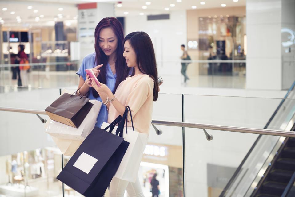 Friends Update Social Media Status in Hong Kong Luxury Mall