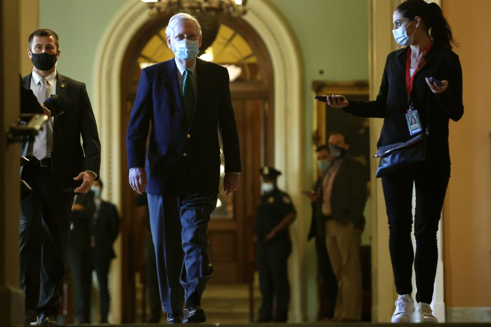 Senate Majority Leader Mitch McConnell Walks To Senate Chamber To Open Today's Session