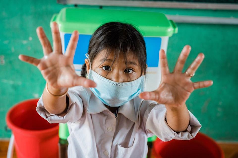 Students at the Krang Snay Primary School in Cambodia's Kampot Province eagerly use UNICEF soap and other hygiene supplies so they can protect themselves and their classmates from COVID-19.