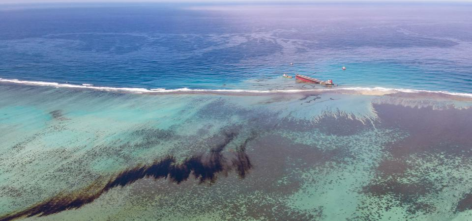 8 Aug: the thin film of the oil slick can be seen drifting away from the lagoon to whale and dolphin nursing grounds (top of image)