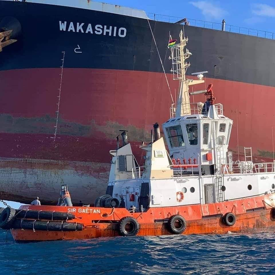 The Mauritius Port Authority tugboat, the Sir Gaetan supporting the salvage operations around the Wakashio, prior to the larger vessel splitting in two on August 15. The hull of the Wakashio can be seen clearly lifted in the air.