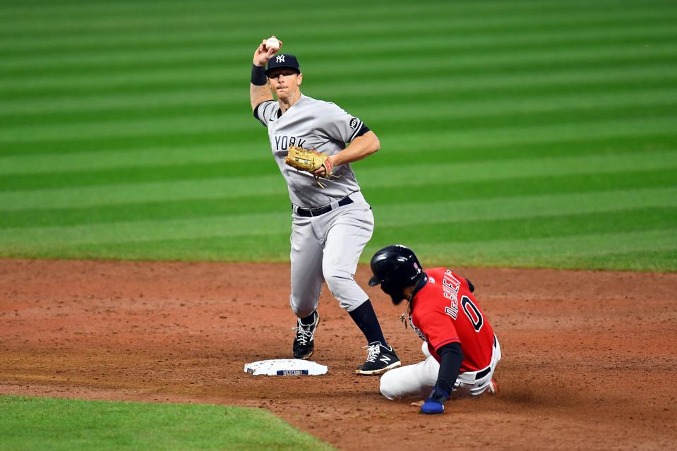 DJ LeMahieu is turning a double play wearing the Yankees' road uniforms.