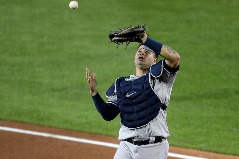 New York Yankees catcher Gary Sanchez drops a fly ball.