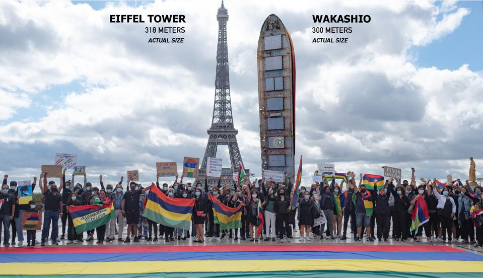 A photoshopped image showing the actual scale of the Wakashio relative to the Eiffel Tower.  Seen here, Mauritian diaspora in France protesting at the oil spill response on August 29.