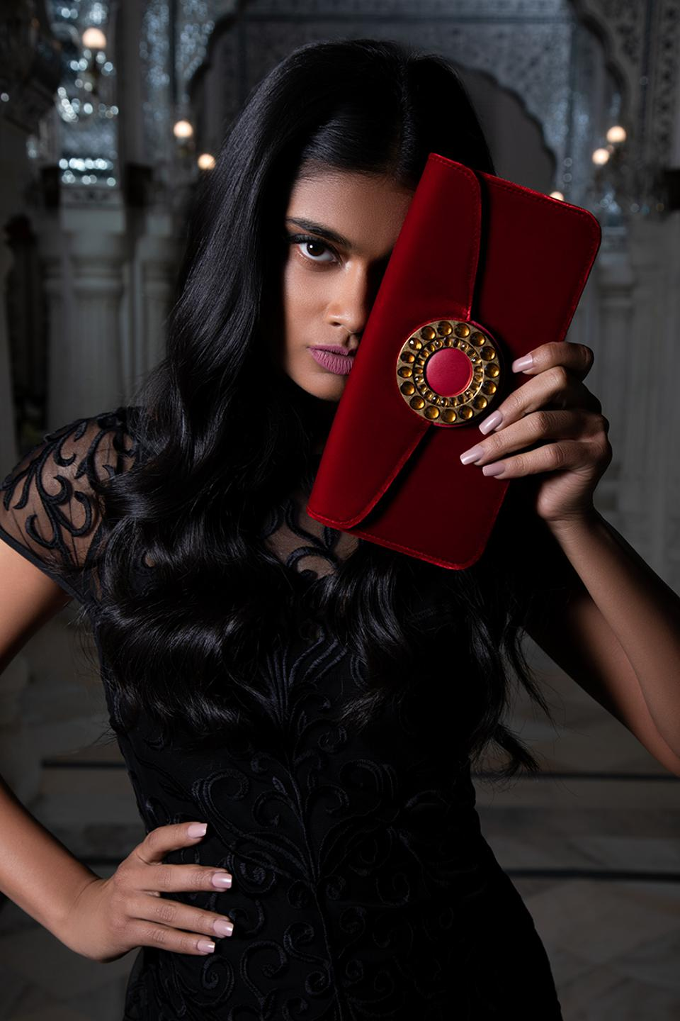 In red, green, and black, Aranyani's evening clutch takes its cues from the simple and elegant architectural beauty of the ancient palaces of Rajasthan. Romancing simplicity with old world elegance, this bag is made of the finest Italian viscose velvet and lined with the finest French calf - Italian finish leather.