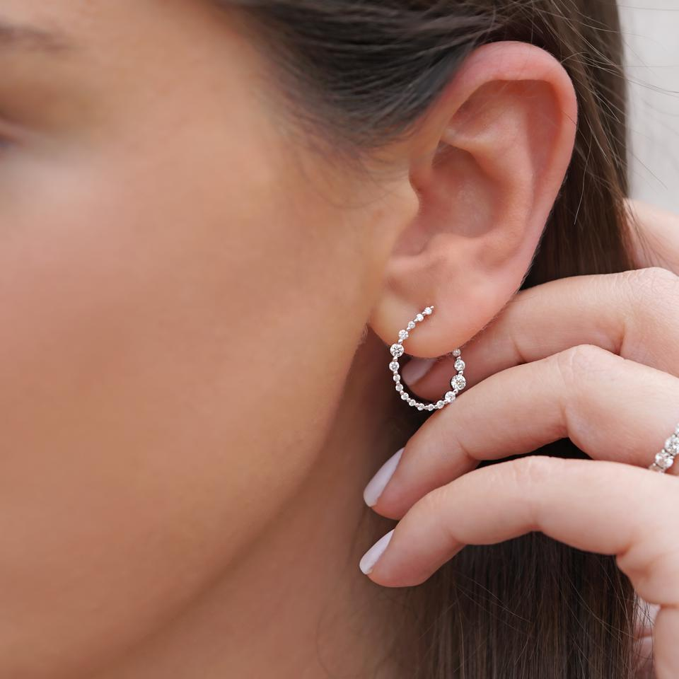 The Soleine Diamond Hoop Earrings are comprised of 38 round brilliant cut diamonds tapered into an 18k white gold galaxy style hoop, totalling 0.76 carats of pure interstellar sparkle.