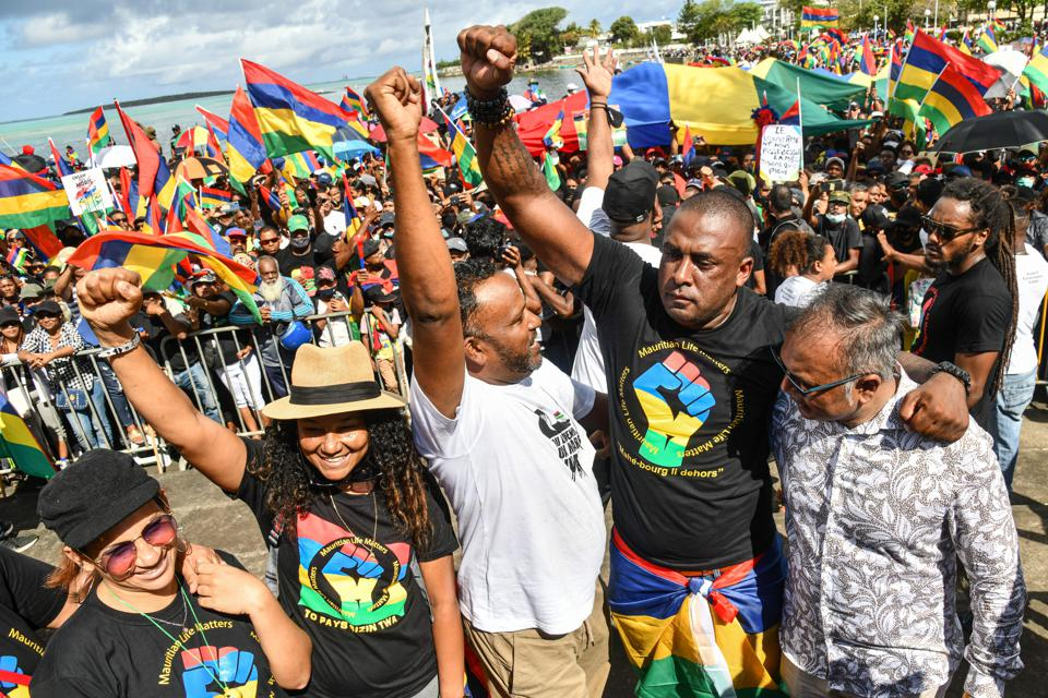 12 September 2020: Mauritian social activist Bruneau Laurette (2nd-R) raises his fist during a demonstration at the town of Mahebourg calling for the government to resign over the oil spill after a cargo ship ran aground in July