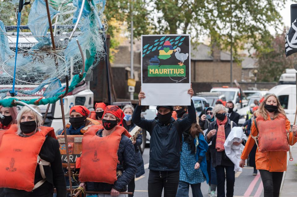 The Wakashio oil spill has galvanized protests around the world.  Seen here, protestors outside the IMO in London.