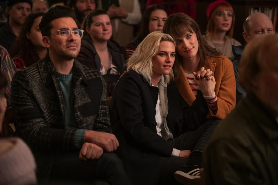 Dan Levy, Kristen Stewart and Mackenzie Davis in a scene from the film 'Happiest Season'