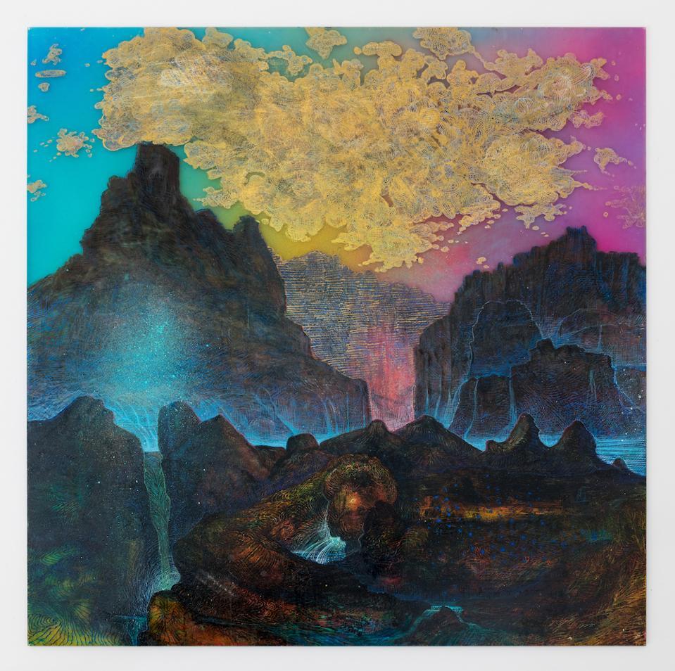 A mountain landscape with a golden cloud