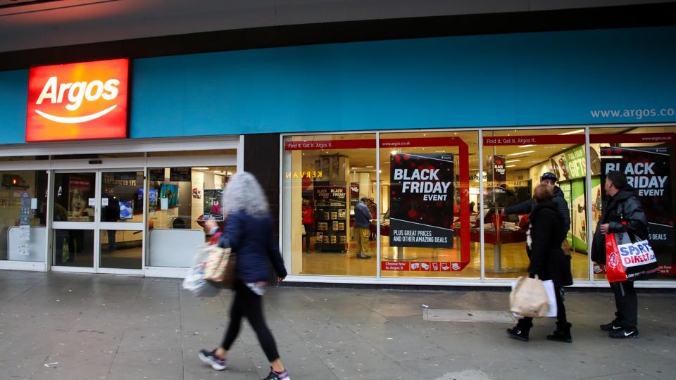 Shoppers are seen standing next to an Argos store in London.