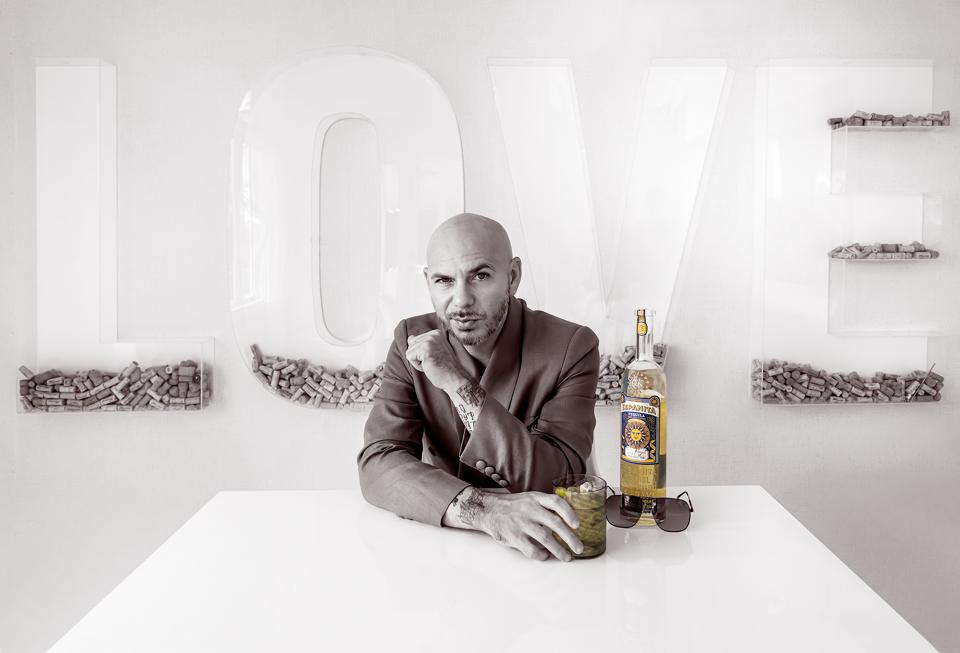 Pitbull poses with a bottle of his Espanita Tequila