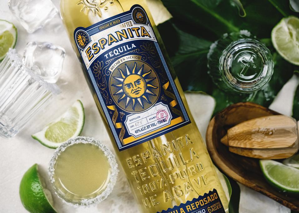 A light amber-hued bottle of Espanita tequila