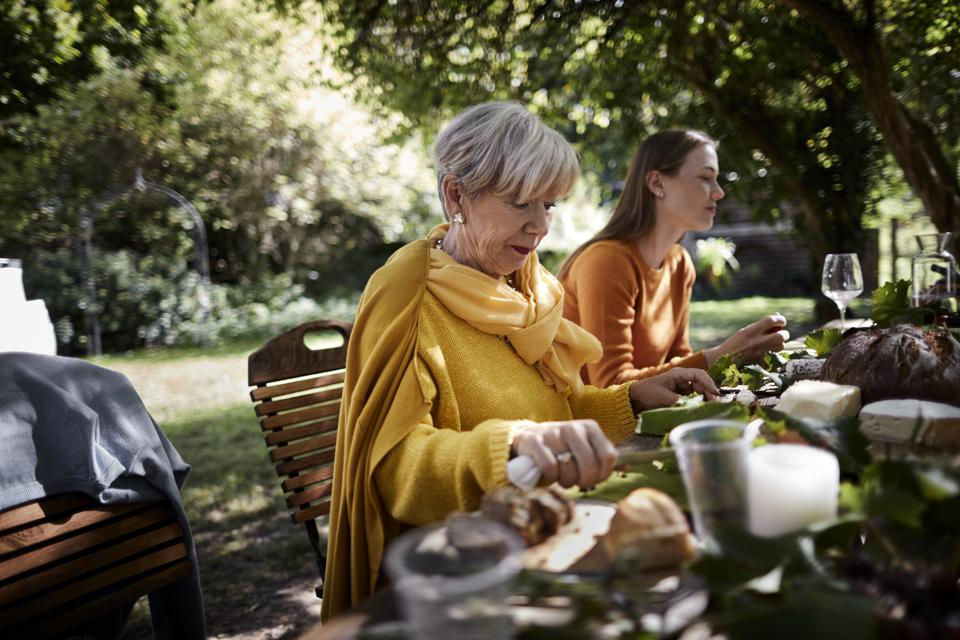 Senior woman and young woman dining al fresco