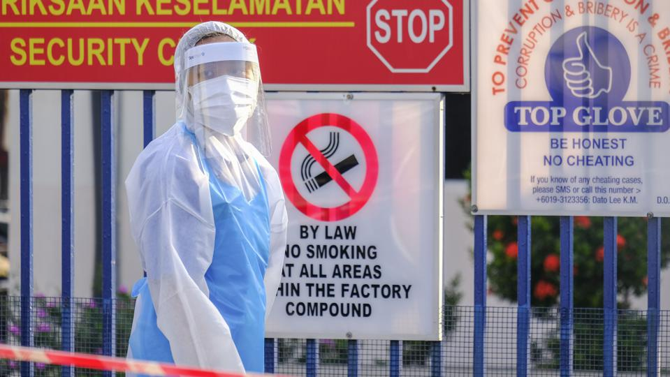 A volunteer wearing protective suit seen during a food...