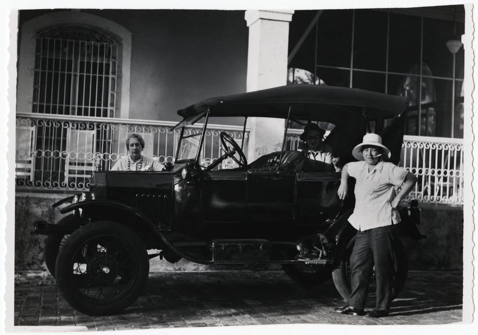 Lydia Cabrera (behind the car) and Josefina Tarafa (standing in front of the car), ca. 1957.