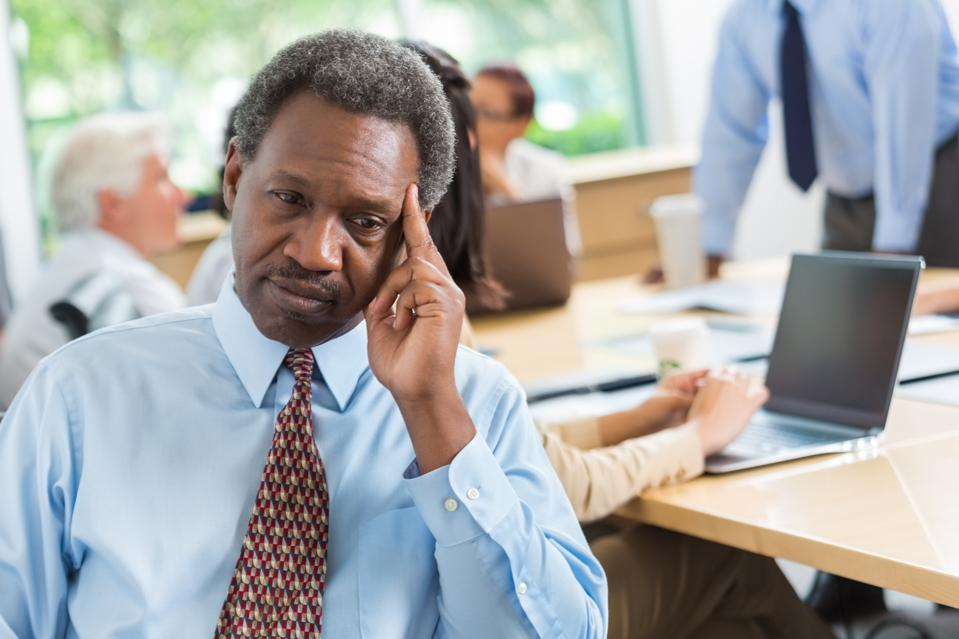 Concerned African American businessman worried during business meeting