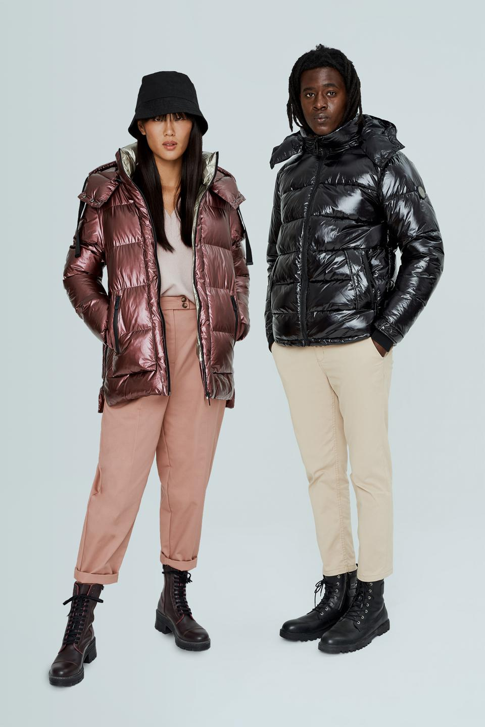 man and woman in shiny puffer jackets