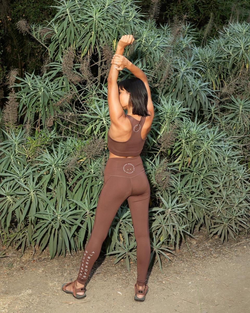 leggings, sports bra, woman of color