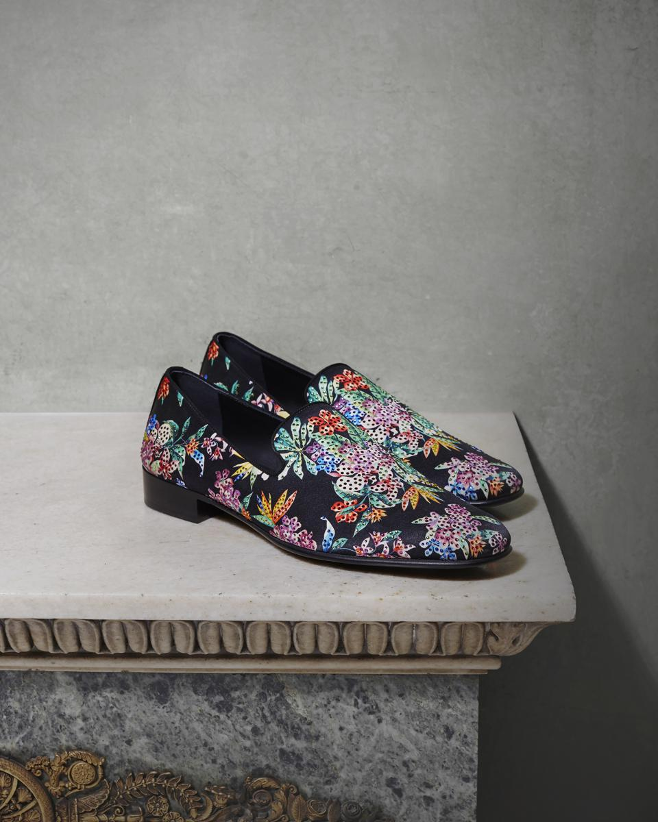 The IBISCO loafer is crafted in a floral silk jacquard reminiscent of patterns from the early 1900's and is further enhanced by bold colors and luminous crystals.