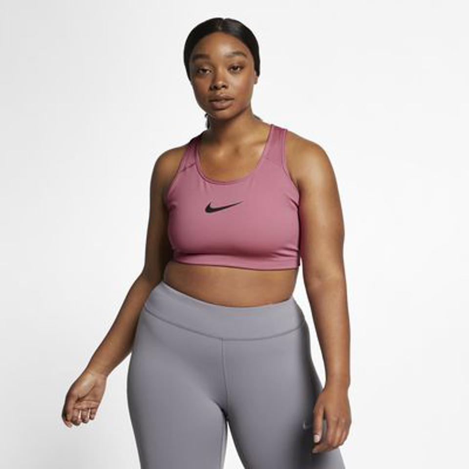 Nike Dri-FIT Swoosh Non-Padded Sports Bra in pink with black detail.